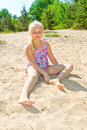 Girl sunbathes on a beach Royalty Free Stock Photo