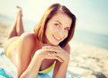 Girl sunbathing on the beach summer holidays vacation and concept Stock Image
