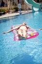 Girl sunbathing on a mattress Royalty Free Stock Photo