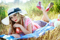 Girl sunbathing on nature in a hat Royalty Free Stock Photo