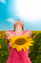 Girl with a sunflower Stock Photography