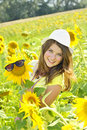 Girl  in a sunflower field Royalty Free Stock Photo