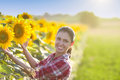Girl in sunflower field Royalty Free Stock Photo