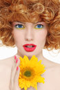 Girl with sunflower portrait of young beautiful curly hair and in her hands Stock Photo