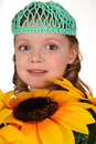 Girl with sunflowers Stock Photos