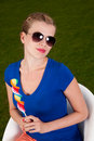 Girl with sunglasses and a lollipop Stock Images