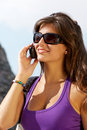 Girl in sunglasses and mobile phone Stock Photo