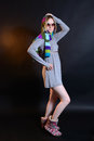 Girl in sunglasses and a scarf in studio fashionable dress Royalty Free Stock Photos