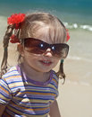 Girl in sunglasses at sea coast. Royalty Free Stock Image
