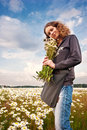 Girl in sunny field with camomiles Stock Images