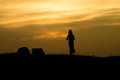 Girl on sunset rock silhouette field two stones and two people Stock Photography