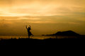 Girl on sunset rock silhouette field two stones and two people Royalty Free Stock Photo