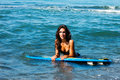 Girl with surfboard in bikini hold on in sea water Royalty Free Stock Image