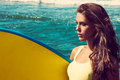 Girl with surfboard young woman portrait hold on seaside beach sunny summer day Stock Photography