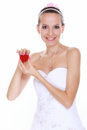 Girl with surprise looks at box with wedding ring isolated bride in white dress red on white background Stock Images