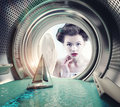 Girl surprised yacht in the washing machine creative concept Stock Images