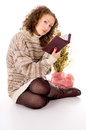 Girl in a sweater and a book Royalty Free Stock Photography