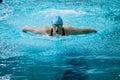 Girl swimmer swims butterfly in pool