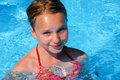 Girl in a swimming pool Royalty Free Stock Photography