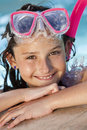 Girl In Swimming Pool with Goggles and Snorkel Stock Photo