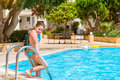 Girl in swimsuit standing at pool, hotel Atali Village, Bali Royalty Free Stock Photo