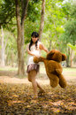 The girl swing a bear Stock Image