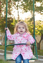 Girl is swinging Stock Images