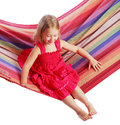Girl swinging on a hammock isolated white background Stock Photography