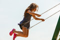 Girl swinging on swing-set. Royalty Free Stock Photo