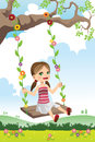 Girl swinging on a tree Royalty Free Stock Image