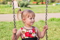 Girl on swings Royalty Free Stock Photography