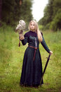 Girl with a sword holding an owl Royalty Free Stock Photo