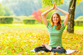 Girl in a t shirt in autumn park doing exercises striped Stock Photography