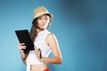 Girl with tablet computer ebook reader touchpad pc internet modern lifestyle concept young summer in hat using reading latin Stock Images