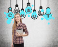 Girl with tablet and consult light bulbs Royalty Free Stock Photo