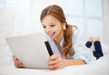 Girl with tablet pc at home education free time technology and internet concept little student Royalty Free Stock Image