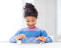 Girl with tablet pc at home education school technology and internet concept little student Stock Photography
