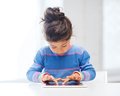 Girl with tablet pc at home education school technology and internet concept little student Royalty Free Stock Photography