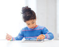 Girl with tablet pc at home education school technology and internet concept little student Royalty Free Stock Photo