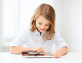 Girl with tablet pc at school education technology and internet concept little student Stock Image