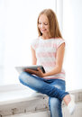 Girl with tablet pc at school education technology and internet concept little student Stock Photography