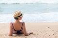 Girl takes a sun bath on a sandy beach Royalty Free Stock Photo