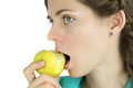 Girl taking a bite of an apple healthy eating Royalty Free Stock Photography