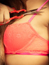 Girl taking off bra, cutting her lingerie with scissors Royalty Free Stock Photo