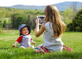 Girl Taking Photo of Baby