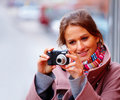 Girl taking photographs from her digital camera Stock Image