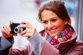 Girl taking photographs on her digital camera Royalty Free Stock Image