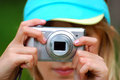 Girl taking photos by digital camera closeup on hands of the outdoor Stock Image