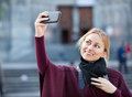 Girl taking picture with her phone in the town young charming smiling Stock Image
