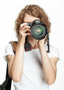 Girl taking a picture using digital camera Stock Images